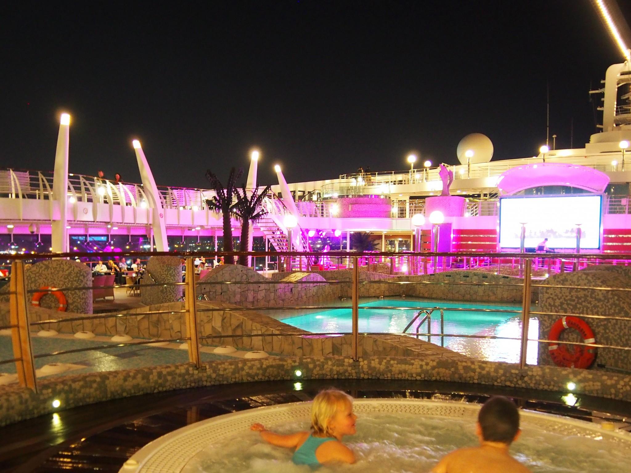 MSC Fantasia pool area at night time Photo © Elämää ja Matkoja