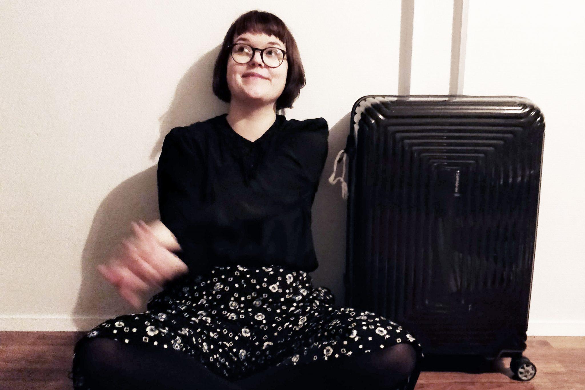 iida ja matkalaukku
