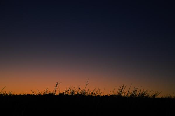 Auringonlasku Ulurun luona