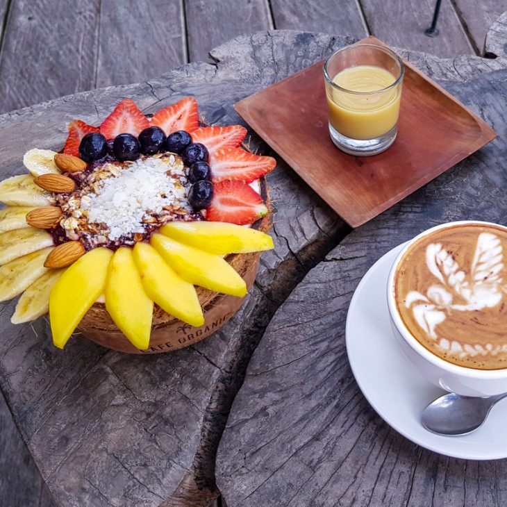 Smoothie bowl breakfast in cafe in Bali