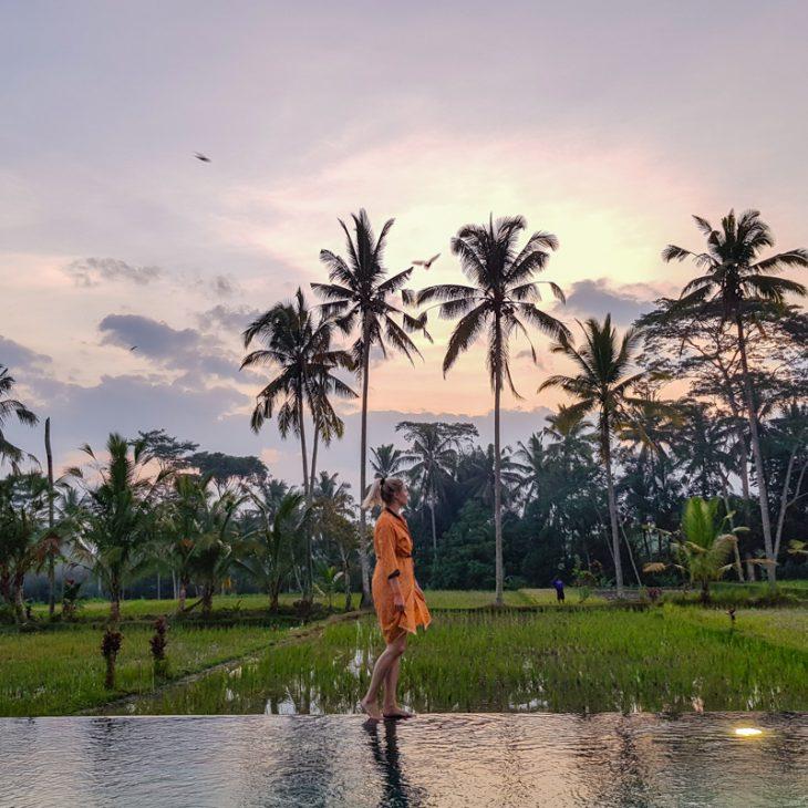 girl walking side of rice field in ubud