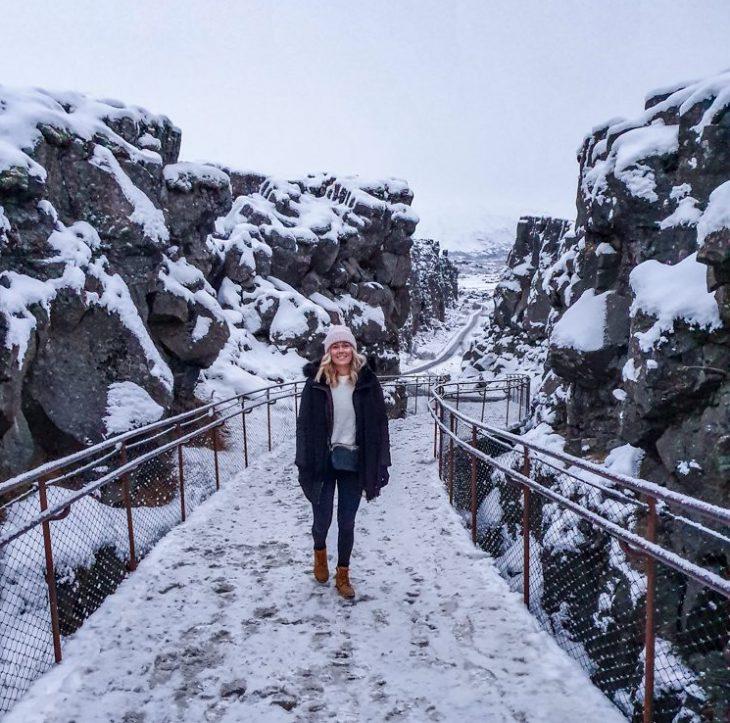 girl standing between two rocks
