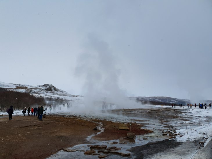 steamy air and people standing around geysir